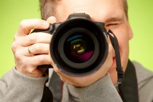 bigstock-Male-photographer-taking-photo-32517002